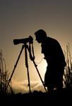 Silhouette of Steve Zmak against a setting sun.
