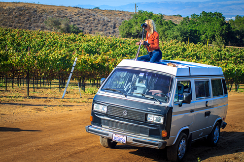 Hahn Wine Workshop - Student on top of car photographing the vineyards