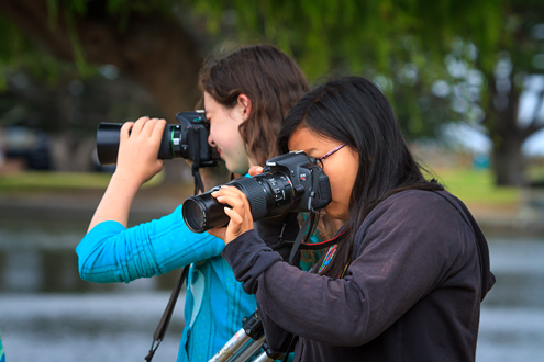 Two young students photographing.