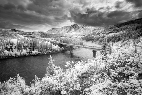 The Denali River Cabins (where I stayed) are on the left along the Nenana River crossed by the George Parks Highway with a summer storm churning over the Alaska Mountains.