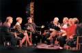 7 experts in communications debate the early influence of the internet on education on a TV stage.