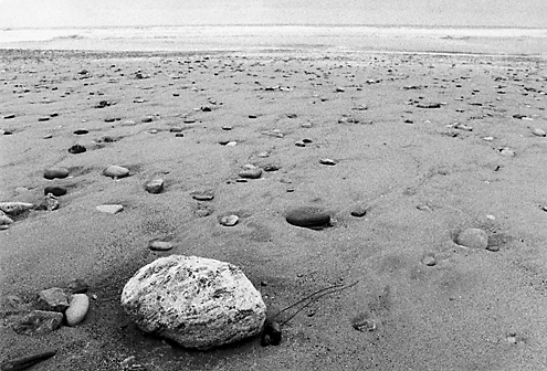 These photos are about being alone in a crowd. We are all the lone rock interconnected to every rock and grain of sand infinitely and cyclically being rearranged by the tides.