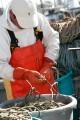 Fisherman preparing a fishing net on his boat.