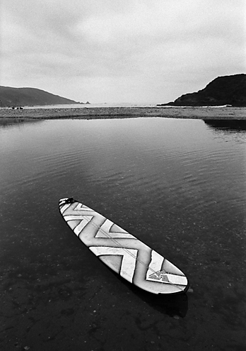 This spot is set 1 mile off Highway 1 in a state park where the Big Sur River (foreground) empties into the Pacific (background). The owner of the lone surfboard was very patient as I composed this shot. When I get in my zone and I lose all track of time.