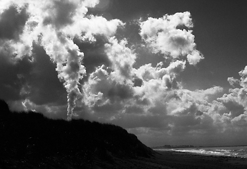 The steam from the Moss landing power plant blended seemlessly with the clouds of a clearing storm over the Monterey Bay.