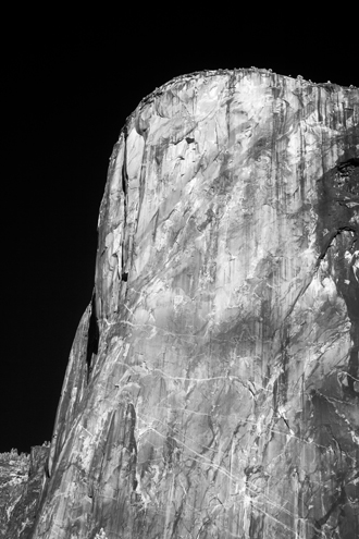 Looking at El Capitan through the invisible infrared spectrum accentuates the scars and wrinkles of an ancient rock face older than the human species.