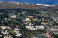 View from the air of a college campus near the ocean.