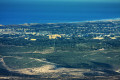 View of the Monterey Bay from the air that includes the former Fort Ord army base, CSUMB, and Marina
