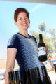 Wrath's winemaker poses with her bottles.