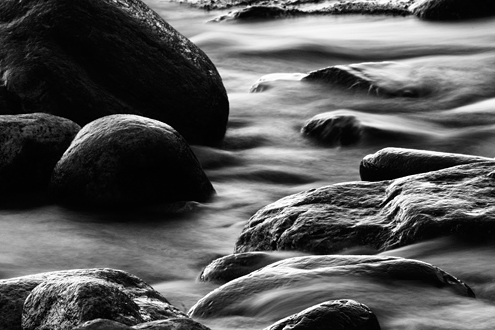 Water's fluidity is only realized by the effects of gravity on it. It's such a powerful force whether affecting a stream trickling down a beach, the moon and tides, or the shaping of galaxies. Part of a black and white portfolio of landscape and abstract nature photographs depicting Science Fiction-like imagery from distant galaxies to Earth's prehistoric natural history.
