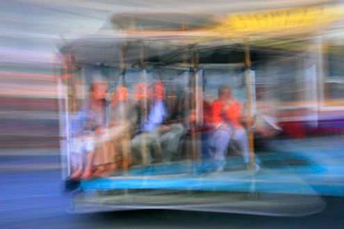 Artistic blurry image of people riding a street car in San Francisco