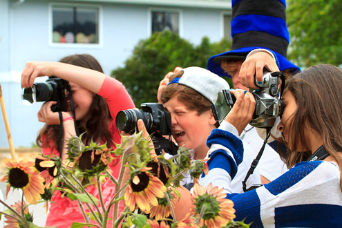 Kids photographing flowers.