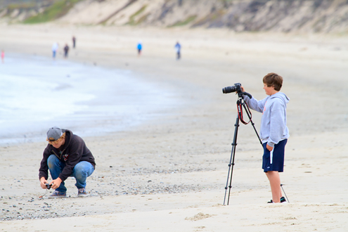 Photo camp kids photographing at the beach.