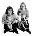 2 women holding 3 babies.