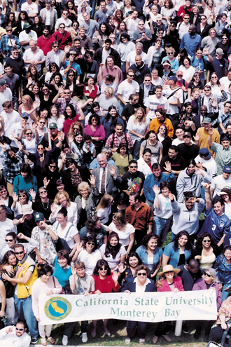 During the first few years of the university, it was tradition to rally everyone on campus (students, faculty, staff, and visitors) in the middle of the quad and take a group photo from one of the rooftops. This is a cropped version of one of those photos so the people overflow the frame.