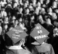 Graduates with messages written on their square caps.