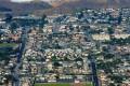 Aerial photo of small coastal city.