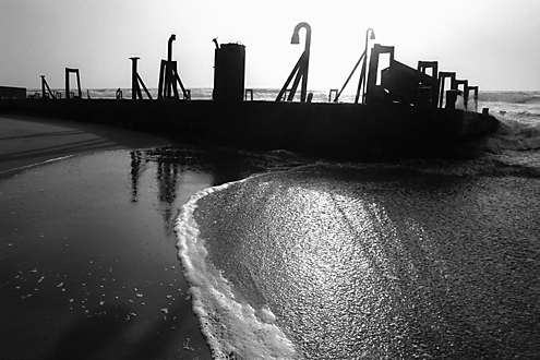 There are a few myths and legends about how this iron barge got beached at the mouth of the Salinas River at the edge of the Monterey Bay National Marine Sanctuary. Regardless of its origin, now the birds and photographers love it. Part 1 of a triptych.