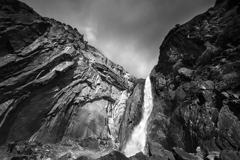 Looking up the enormous rock face divided by pure white cascading water with a storm forming overhead portrayed itself as a dark angel spreading its wings and engulfing me.