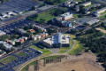 College campus library, science building, and dormitories from the air.