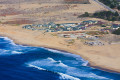 Marina State Beach and Sanctuary Dunes Resort seen from the air.