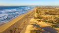 Aerial photo looking north up the sand dunes and coastline of the Monterey Bay from a drone.