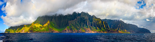 The Na Pali Coast on the eastern side of Kauai is like Hawaii's Big Sur—spectacular, treacherous, dramatic, wild, and a kaleidoscope of saturated colors and ever changing weather. This image is comprised of nine wide angle photos stitched together to show the whole island.