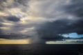 A localized rain storm sweeps across the Pacific Ocean off the coast of Kauai.