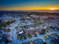 A beach cityscape at sunset shot with a drone camera.