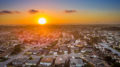 Sunset over the Monterey Bay with a neighborhood in the foreground shot with a drone camera.