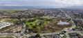 Drone photo of a suburban park, roads and neighborhood.
