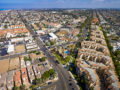 Streets, houses, apartments, and shopping centers go on endlessly. Shot with a drone camera.
