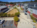 Village center shot from a drone includes apartments, theater, offices, park and art galleries.